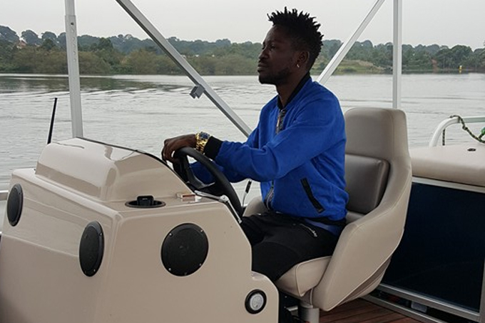 Bobi Wine cruising on the lake in the new boat.