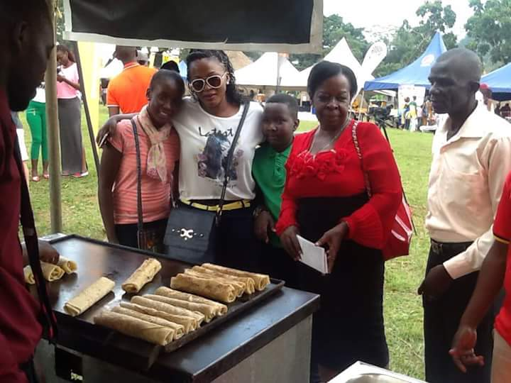 Minister Mutagamba at a rolex stall.
