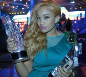 Zari poses with Diamond's awards.