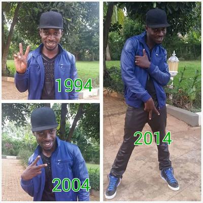 Singer Bobi Wine shows the evolution of the V sign.