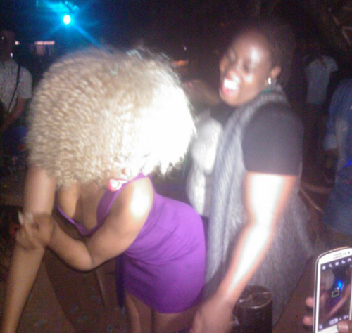 Sheebah being rub-a-dubbed by a friend.