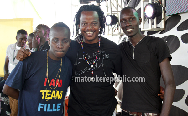 The artiste managers Mc Kats, Emma Carlos and Lawrence Labeja.