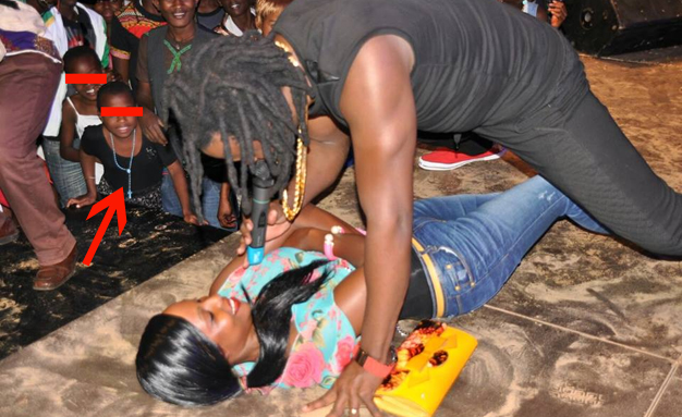 Children watching as Bebe Cool does his thing at Resort Beach.