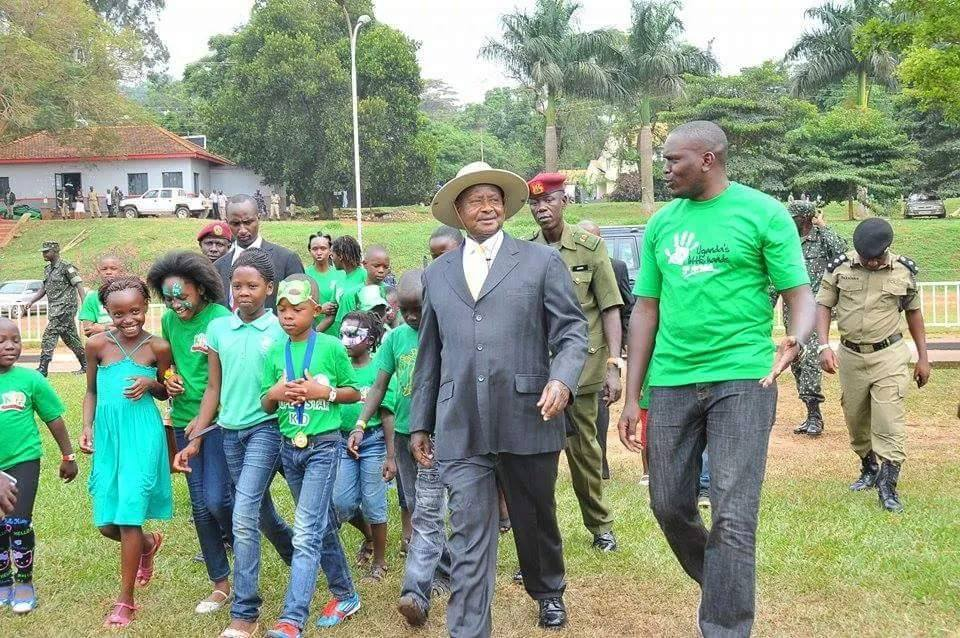 President Museveni is welcomed by Uganda's Little Hands Go Green CEO Joseph Masembe at the event.