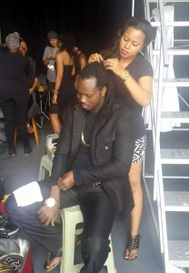 Zuena working on Bebe Cool's hair on the set.