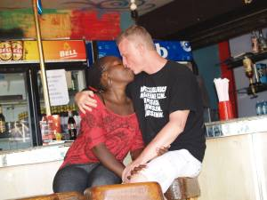 "The ""couple"" share a passionate kiss in Kalangala."