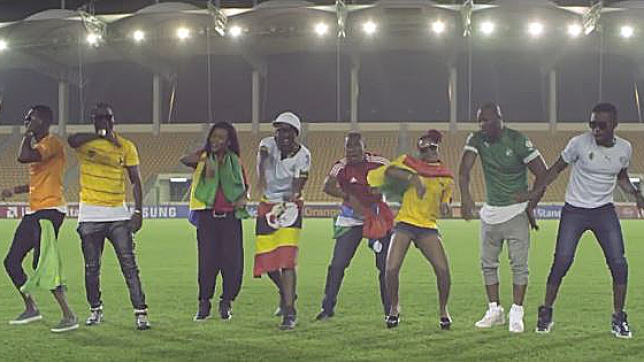 The African stars in the Afcon song video. Kenzo represented with the Uganda flag, though he wore a Ghana jersey.