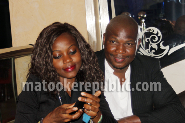 The lead actor Charles Kabogoza and his partner.