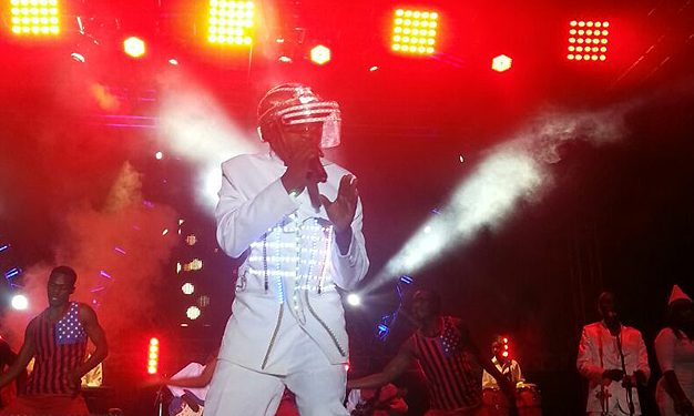 David Lutalo in a futuristic outfit on stage.