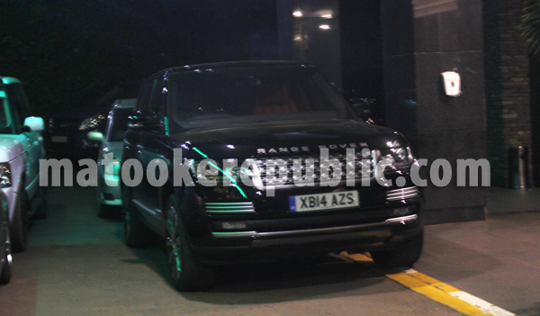 The Range Rover is registered with British licence plates