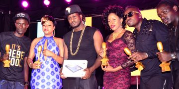 Bebe, Zuena and some of the Gagamel members with his trophies as Bebe holds a Huawei tab that came with winning the Best Male Artiste accolade.