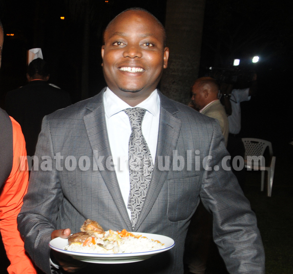 Youth Minister Ronald Kibuule in a jolly mood - must have been the food.
