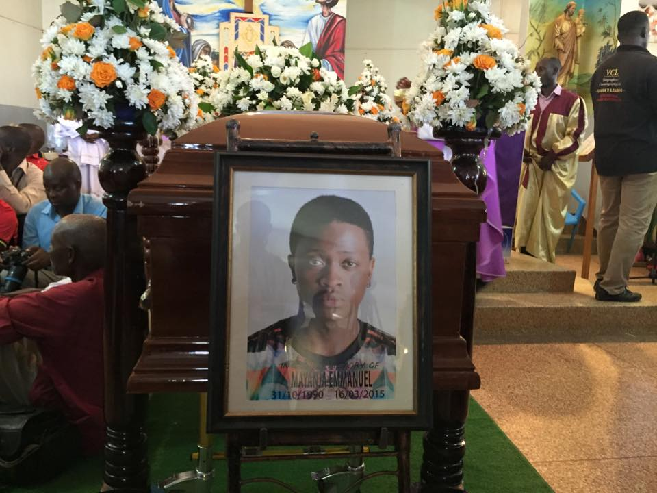 AK 47's body at the requiem mass.
