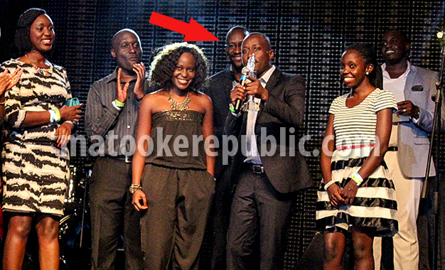 Bush Baby wears a smile as Malcolm Musiime gives an acceptance speech on behalf of NTV staff.