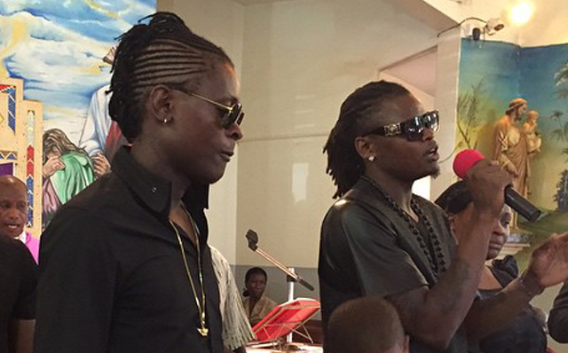 Chameleone and Pallaso at the funeral service.