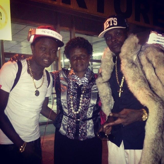 Ak 47, mummy and Jose Chameleone at the airport as she bid farewell to the boys for a UK trip. Chameleone took AK47 under his wing at Leone Island until he joined Team No Sleep last year.