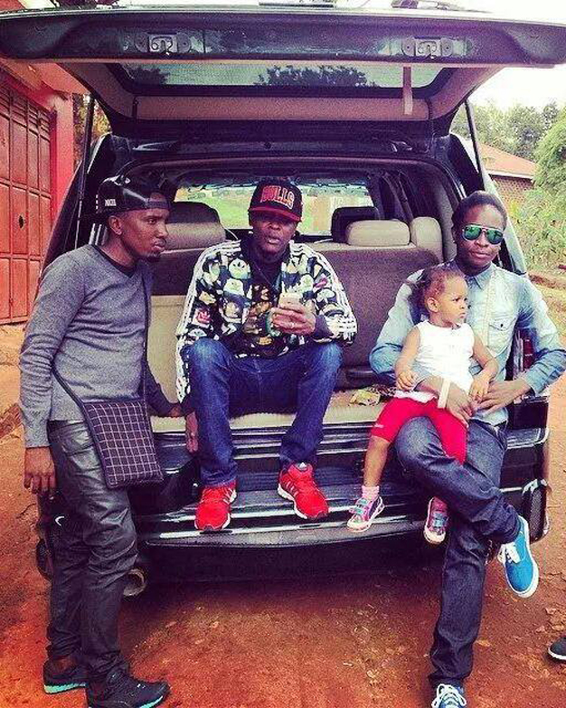 Family: Chameleone's former manager Sam Mukasa, Chameleone, plus AK carrying Chameleone's daughter. Sam was later to leave Leone Island with AK47.
