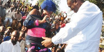 Harriet Kisakye and Dr Besigye on his 2011 campaign trail.