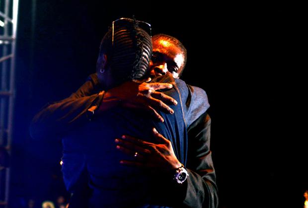 AK-47 and Chameleone embrace at Chameleone's Tubonge Concert last year.