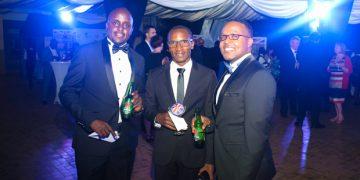 Heineken's Akandwanaho (L) and Steven Baryevuga (R), with Bayimba Foundation's Faisal Kiwewa.