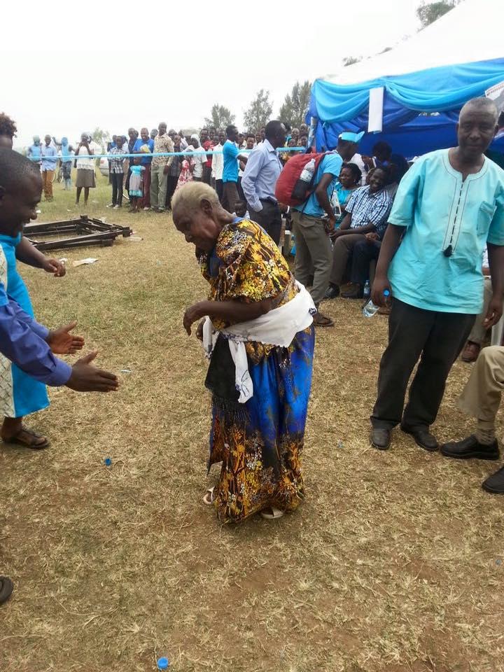 An elderly lady dances at Besigye's rally.
