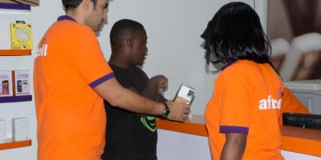 Africell's Commercial Director,  Milad Khairallah (L) and other Africell staff.