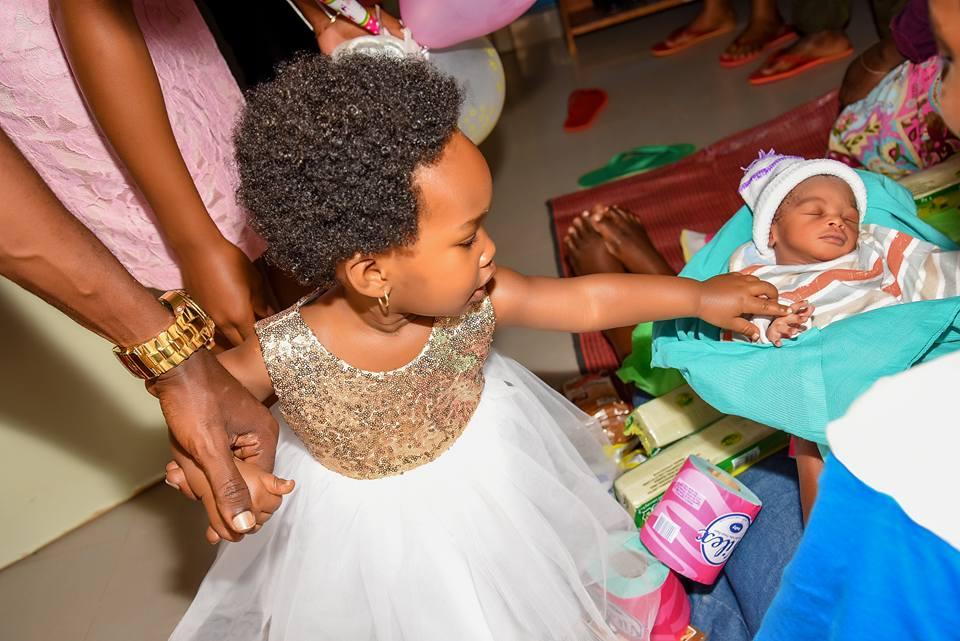 Suubi greets a newly born baby.