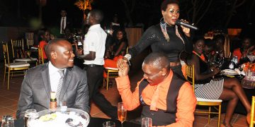 Kibuule eyeing Luzinda with Desire at his friend Jack Pemba's birthday party.