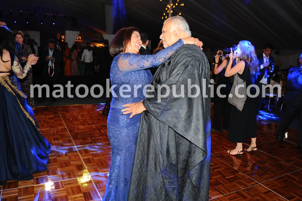 The girls are gone, but we still have each other. Sudhir and his wife dance.