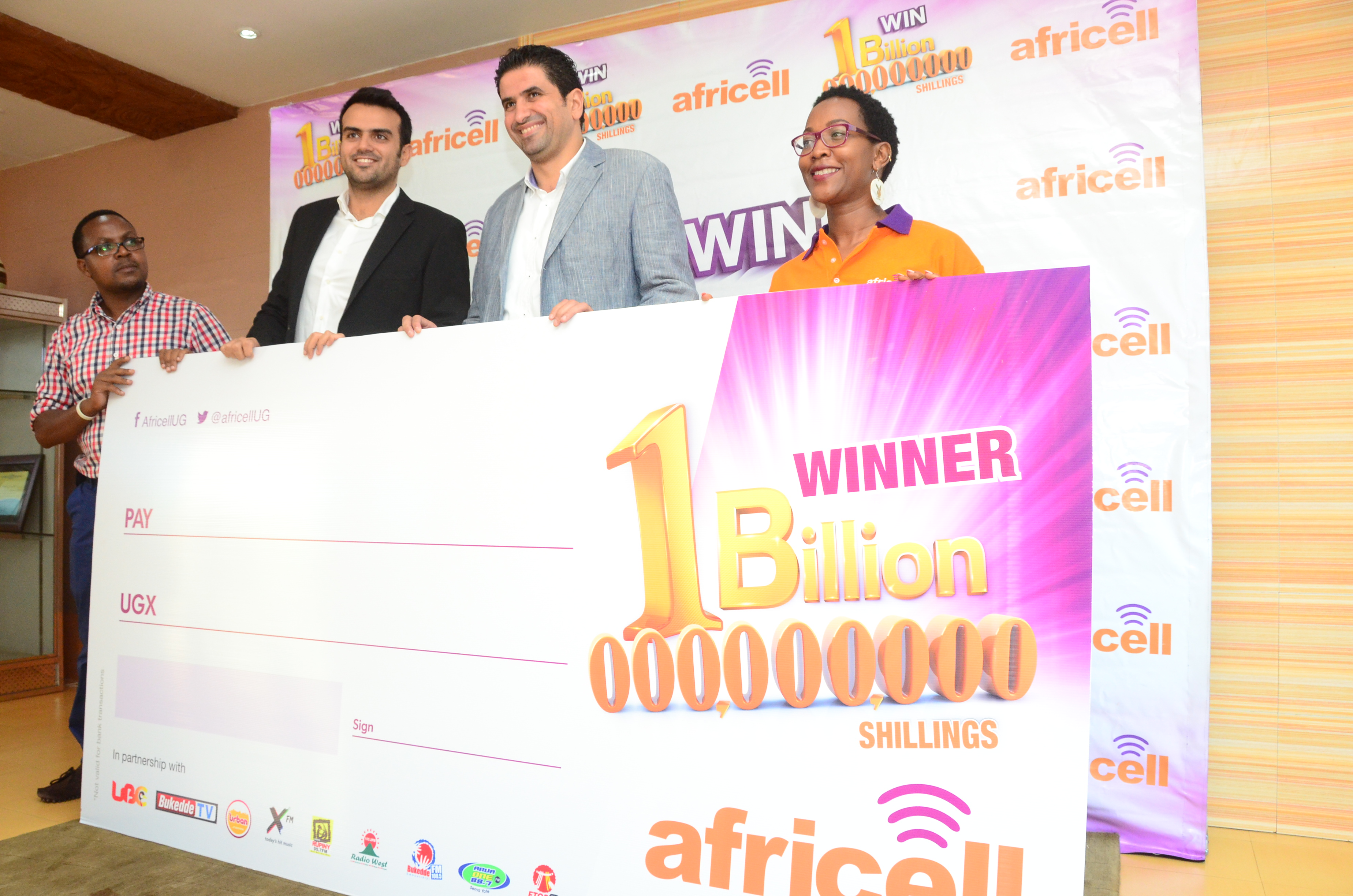 steven-baryevuga-corporate-communications-milad-khairallahcommercial-director-mohammad-ghaddar-chief-operations-officer-nelly-nalugwa-media-coordinator-at-the-launch-of-africell-one-billion