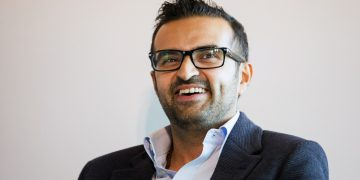 Ashish Thakkar, founder and chief executive officer of Mara Group,  smiles during a forum on African energy and innovation, at the Newseum in Washington, D.C., on August 4, 2014.  More than 40 heads of state from Africa are in Washington this week for the US-Africa Leaders Summit and surrounding events. (Photo by Drew Angerer/Bloomberg)