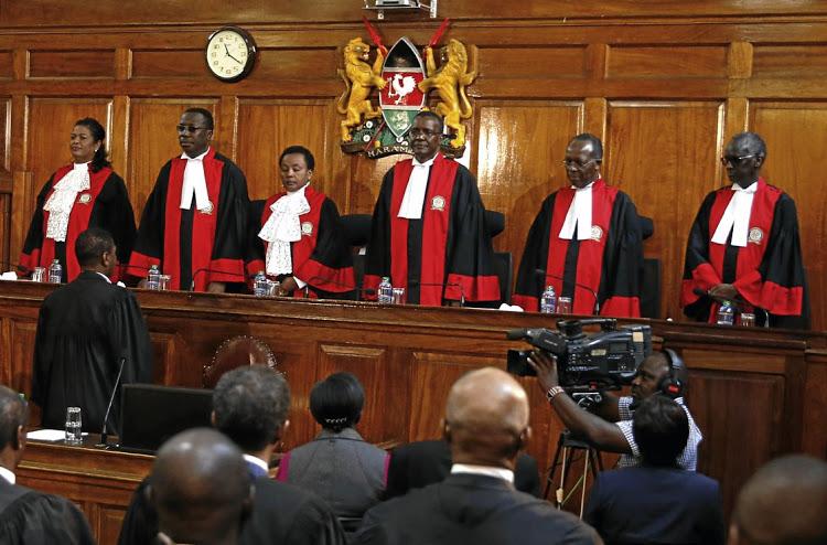 Judges stand in court as President Uhuru Kenyatta's election win was declared invalid in Nairobi, Kenya, September 1, 2017. REUTERS/Baz Ratner