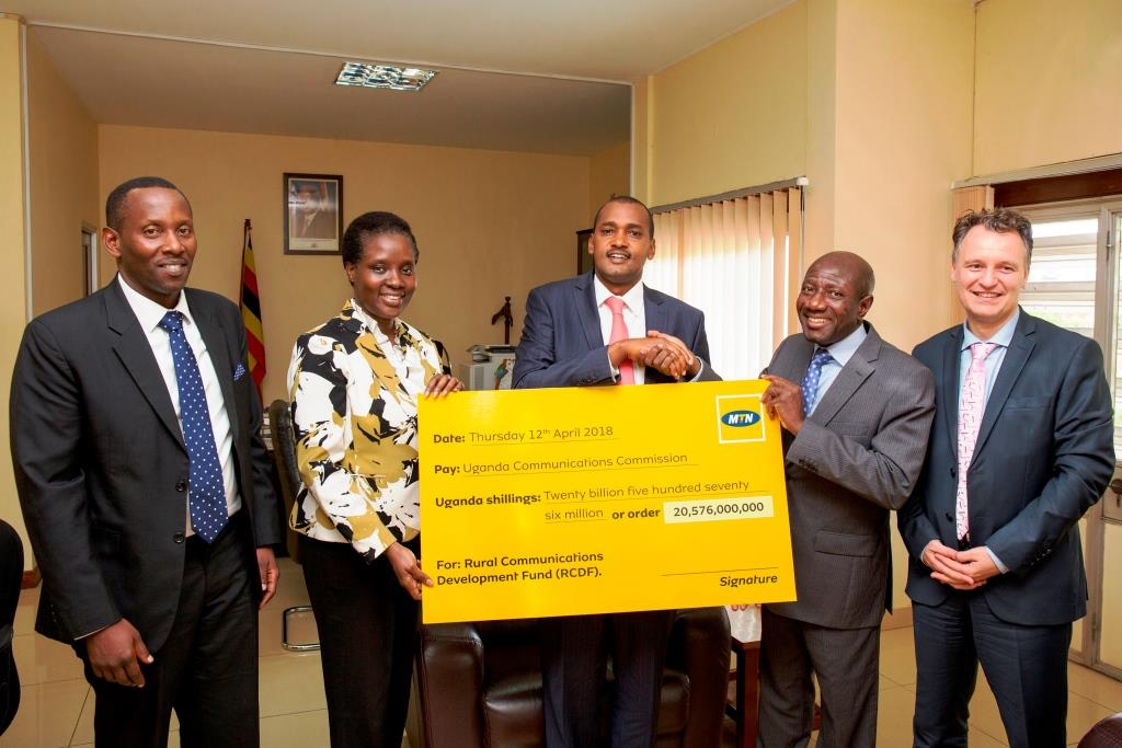 MTN GROUP VP HANDS OVER UGX 20 BN CHEQUE TOWARDS RURAL COMMUNICATIONS DEVELOPMENT FUND - PHOTO 1