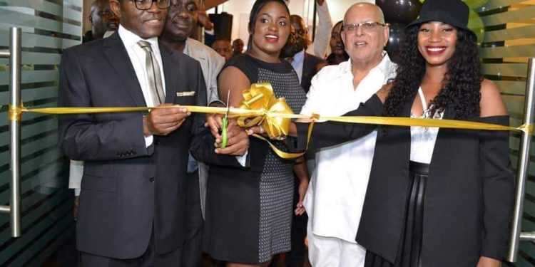 Sheebah Karungi, Katikkiro Charles Peter Mayiga, Dr Sudhir Ruparelia and Joy Namyalo Zizinga cutting the ribbon to open up the Branch at Kingdom Kampala yesterday.