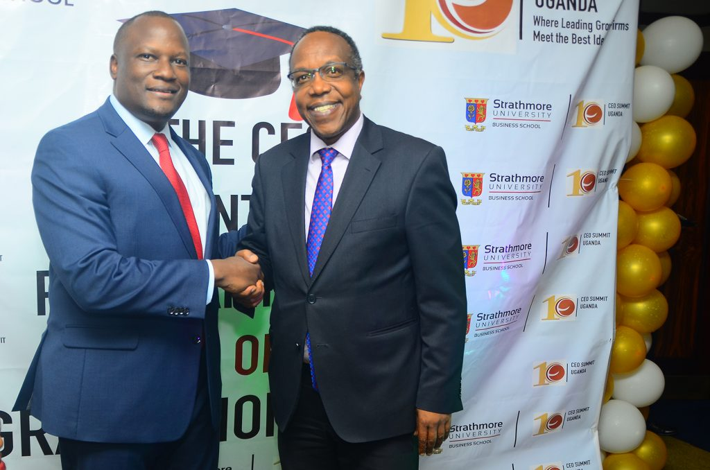 Dr George Njenga executive Dean Strathmore University  hangs with the night's Keynote speaker DFCU's Managing Director Mathias Katamba at the graduation on yesterday.