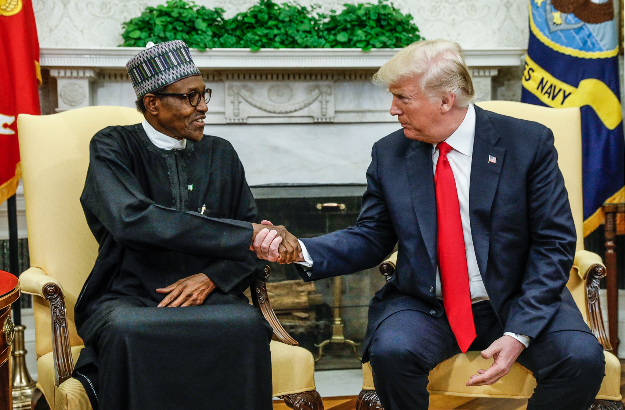 U.S. President Donald Trump meets with Nigeria's President Muhammadu Buhari in the Oval Office of the White House in Washington, U.S., April 30, 2018. REUTERS/Kevin Lamarque - HP1EE4U19EAHX