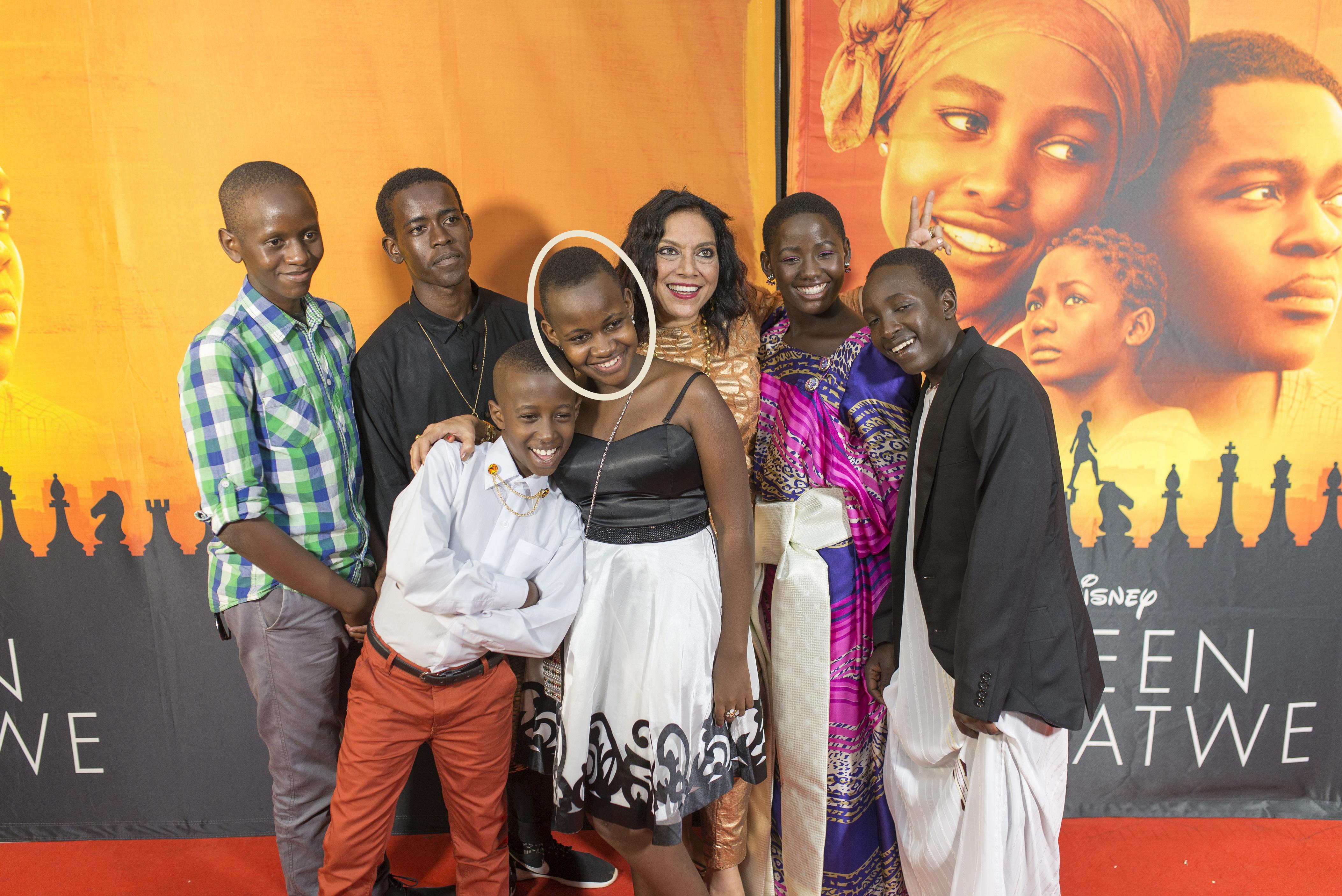 """Ronald Ssemaganda (Ivan), Ethan Lubega (Benjamin), Nikita Waligwa (Gloria), Mira Nair (Dir), Madina Nalwanga (Phiona), Martin Kabanza (Brian) at the Uganda premiere of Disney's """"Queen of Katwe"""" on Saturday, October 1, 2016 in Kampala. The film, starring David Oyelowo, Oscar winner Lupita Nyong'o and newcomer Madina Nalwanga, is directed by Mira Nair and opens on 7 October 2016."""