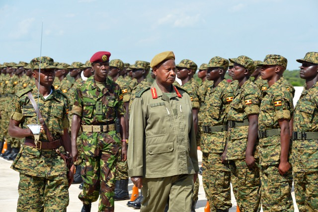 President Yoweri  Museveni inspecting a guard of honor mounted by recruits he passed out, he passed out 2916 who completed a infantry basic course  at Kaweweta Recruits Training School in Nakaseke District on July 1, 2014. PPU photo.